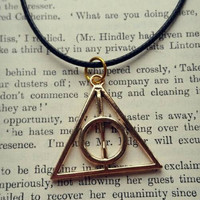 Gold tone Deathly Hallows Harry Potter Necklace on leather cord