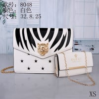 white gucci handbag plus purse