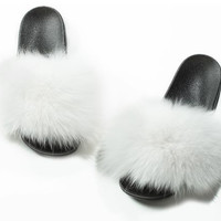 White fox fur slides