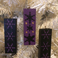 Christmas ornaments, wooden tree decorations, Nordic Soul, painted snowflake design, Black Purple and Gold