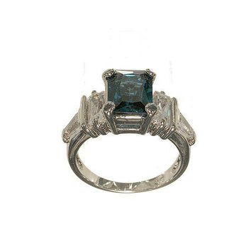 Silvertone Three Stone Fashion Ring with Emerald Cut Genuine Blue Zircon Center and Fancy Cut Clear Cubic Zirconia Side Stones