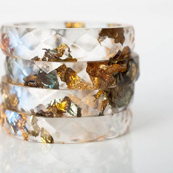 size 7 thin multifaceted eco resin ring | clear resin with variegated metallic gold leaf flakes