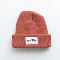 Woven Patch Logo Beanie in Rust