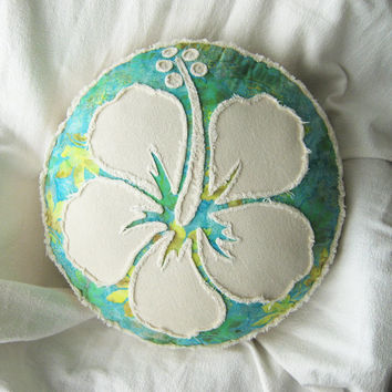 Hibiscus flower applique on peridot, aqua, and yellow batik and natural denim boho round pillow