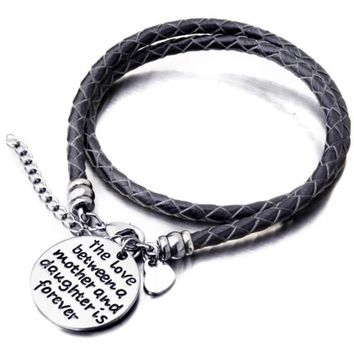 The love between a mother and daughter is forever hand-stamped bracelets