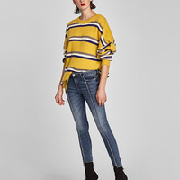 SKINNY JEANS WITH FRAYED SEAMS DETAILS