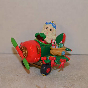 Santa's Airplane Ornament Vintage Christmas Santa Claus Ornament 1990s Santa Flying Airplane Toys Red and Green Ornament Holiday Decor