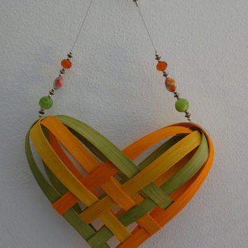 Hand Woven Heart Basket  in Yellow, Orange and Chartreuse with beaded handle.  Heart Basket. Hand Made Baskets in fun colors!