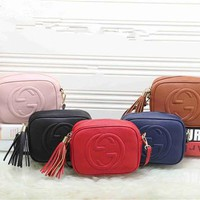 """Gucci"" Fashion All-match Letter Logo Embossed Single Shoulder Messenger Bag Women Solid Color Tassel Zip Small Square Bag"