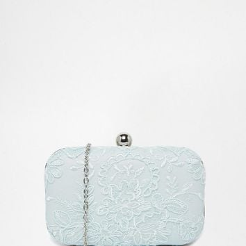Chi Chi London | Chi Chi London Clutch Bag in Mint With Piped Lace Overlay at ASOS