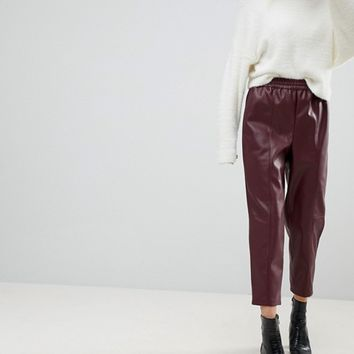ASOS Leather Look Tapered PANTS With Elasticated back at asos.com