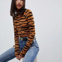 ASOS DESIGN high neck body with long sleeves in animal print at asos.com