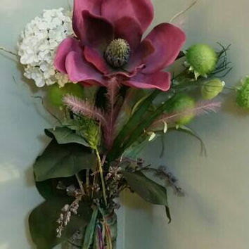 Light green tinted jar file with potpourri holding beautiful long stem flowers ..peaceful. .