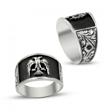 Eagle headed silver mens ring