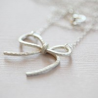 Swing a swish bow necklace matte silver by moncadeau on Etsy
