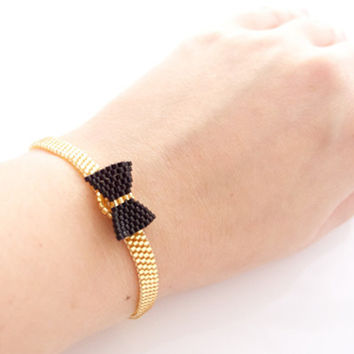Black Bow Bracelet on Gold Wristband with elastic clasp