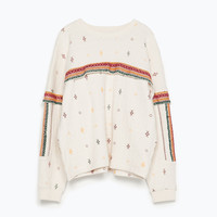Printed sweatshirt with sleeve applique