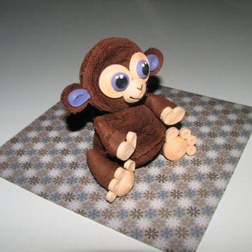 Quilling art. Cute little monkey of paper. Symbol 2016 year