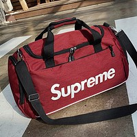 Supreme Tide brand men and women outdoor sports travel large capacity luggage bag handbag red
