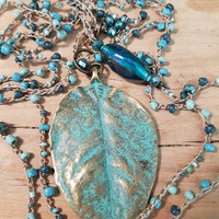 Long two strand urban gypsy beaded crochet adjustable necklace with large patina brass leaf pendant and glass pendant can be worn as choker