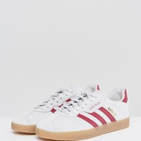 adidas Originals Gazelle Super Sneakers In Gray With Gum Sole at asos.com