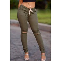 Stylish Drawstring Solid Color Skinny Ripped Pants For Women