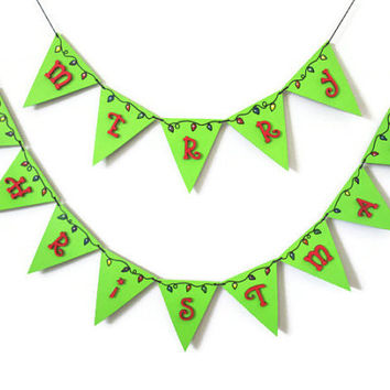 Merry Christmas Banner whimsical holiday decoration hand painted in lime green with red letters and colorful Christmas lights wooden garland