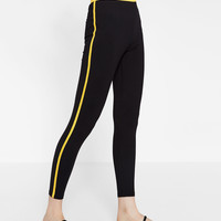 TROUSERS WITH A COLORED STRIPE DETAILS