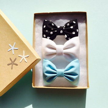 Black and white polka dot, Tiffany blue, and white denim Seaside Sparrow hair bows. Perfect beachy birthday present for any girl.