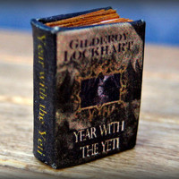 """Year With the Yeti"" miniature book by Gilderoy Lockhart in tiny half inch scale"
