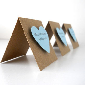 Raised Heart Place Cards, 50 - Pick your heart colors for lovely square kraft paper place cards with guests' names printed in dark gray ink.