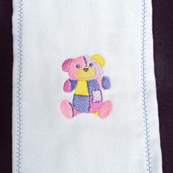 Burp Cloth with embroidered pink, purple and yellow patchwork girl teddy bear. It can be personalized for an extra charge.