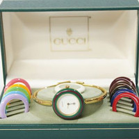 80s vintage Gucci bezel bangle watch with complete 12 different color frames choice. Red and Green webbing sherry line collection.