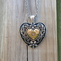 Bullet jewelry. Western necklace with heart pendant and bullet casing
