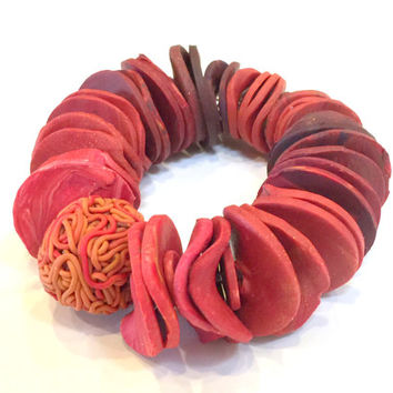 Vibrant polymer clay stretch bracelet of custom blended and marbled orange, red, yellow beads, one of a kind