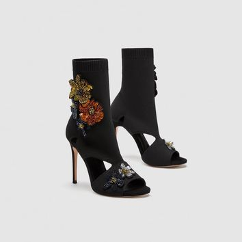 HIGH HEEL SOCK-STYLE SANDALS WITH FLORAL DETAIL DETAILS