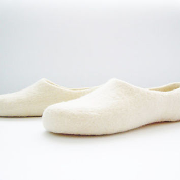 Simple felted wool slippers of custom chosen color.