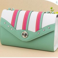 Green and white fashion bag
