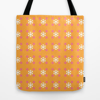 White pink floral on orange Tote Bag by cycreation