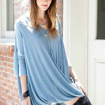 Draped an open front tunic top with overlapping featuring soft thin knit material, deep v-neckline, loose fitting, criss-cross draping ab the bottom hemline, asymmetrical draped side, long sleeve and draped sugar hatchi surplice detail back. Pair with high