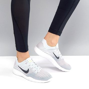Nike Training Free Flyknit Trainers In Grey And Blue at asos.com