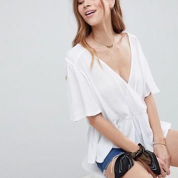 ASOS DESIGN Oversized Wrap Top With Flutter Sleeve at asos.com