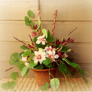 Handmade Artificial Floral Arrangement: Floral Arrangement with Vines and Wooden Accents Potted in a Wicker Basket