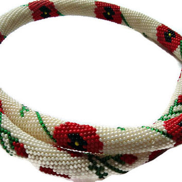 Bead crochet necklace with flowers design in beige, red and green