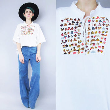 60s 70s White Cotton Peasant Blouse Hippie Boho Embroidered Blouse Houses Birds Novelty Lace Up Drawstring Short Sleeve Tunic Top (L/XL)