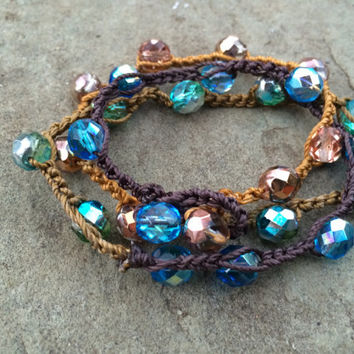 Sand, Sea and Sky bracelet wrap. Czech glass beads crocheted onto thick nylon cord with bead and loop closure