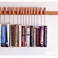 Buy Custom made wooden book rack in Oak. Movable pins.The pins also work as bookmarks. on Shoply.
