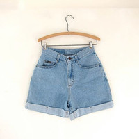 Vintage 80s light blue jean shorts. high waisted shorts. rolled cuffed shorts.