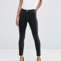 ASOS RIDLEY Skinny Jeans in Washed Black at asos.com