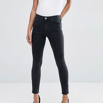 ASOS DESIGN Ridley high waist skinny jeans in washed black at asos.com